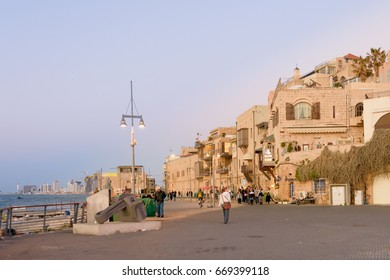 TEL AVIV - MARCH 4, 2017: People touring the beautiful old international city of Jaffa near the Mediterranean port on a warm spring evening