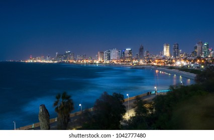 Tel Aviv night skyline with beaches, skyscrapers and seaside.