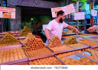 TEL AVIV - OCT. 11, 2017: Knafeh and Baklava stall offering middle eastern delicacies at the busy Carmel Market in Tel Aviv, Israel on the eve of Sukkot