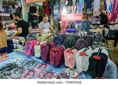 TEL AVIV - OCT. 11, 2017: Havaianas flip flop and sandal stand at the busy Carmel Market in Tel Aviv, Israel on the eve of Sukkot