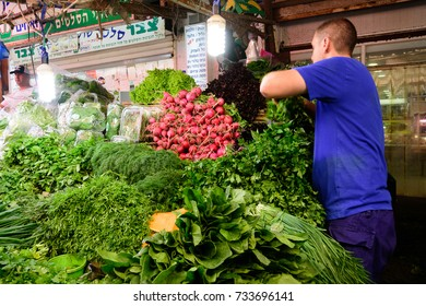 TEL AVIV - OCT. 11, 2017: vegetable shop and stand at the busy Carmel Market in Tel Aviv, Israel on the eve of Sukkot