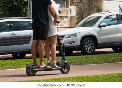 Tel Aviv Rothschild street, April 28 2018, unidentified Man and women riding an electric scooter In the city