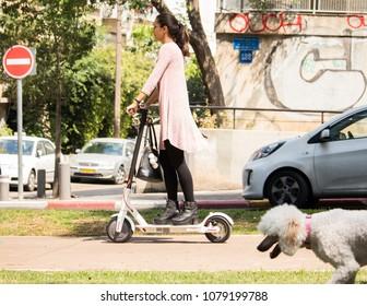 Tel Aviv Rothschild street, April 28 2018, unidentified Women riding an electric scooter