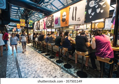 TEL AVIV, SEPT 25, 2015: People having lunch in a modern open kitchen restaurant the new Sarona food market