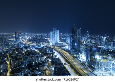 Tel Aviv Skyline At Night, Skyscraper and Ayalon Freeway - Toned In Blue
