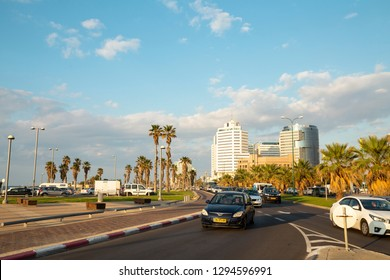 Tel Aviv - Yafo, Israel - December 23, 2018: A golden sunset scene of Nahum Goldman and  Jerusalem avenue and the busy traffic in the end of the day.