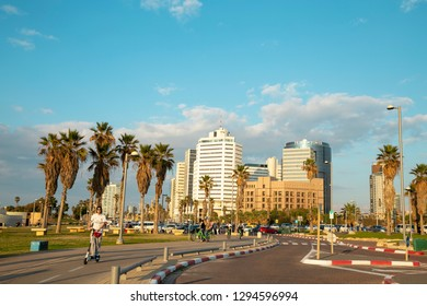 Tel Aviv - Yafo, Israel - December 23, 2018: A beautiful golden sunset scene of Nahum Goldman and  Jerusalem avenue and the modern architecture at the horizon.