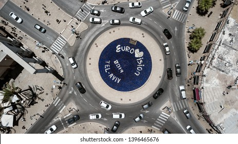 Tel Aviv - Yafo/Israel - 05.11.2019: The inscription EUROVISION 2019 in a flowerbed in the middle of a roundabout on which cars are moving.