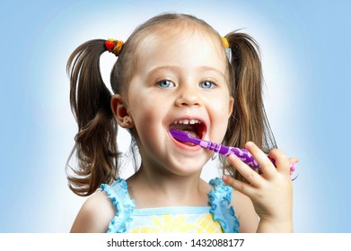 TEL AVIV/ISRAEL - 07/16/2018  photo of girl brush her teeth with toothpaste on toothbrush