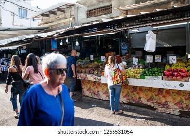 Tel Aviv/Israel November 19, 2018 Shoppers at Carmel Market Shuk HaCarmel in Tel Aviv, Israel.