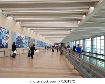 TEL AVIV,ISRAEL- October 3,2017 :Passengers in Departure area at the Terminal 3 in the Ben Gurion international airport . Jewish orthodox With Sukkot Holiday belongings in the departure passage.Israel