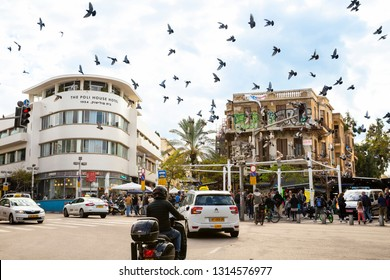 Tel Aviv-Yafo, Carmel market, Israel - December 28, 2018: Busy Magen David square - view of crowded entrance and flying pigeon birds at the famous Carmel Market in Tel Aviv, Israel