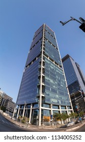 Tel Aviv-Yafo, Israel - June 9, 2018: Modern architecture in financial district of Tel Aviv. Business towers, office buildings around Ayalon Highway. Electra and Alon Towers vertical panorama