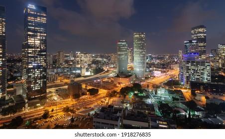 Tel Aviv-Yafo, Israel - September 23, 2020: Tel Aviv night aerial panorama. Modern glass skyscrapers