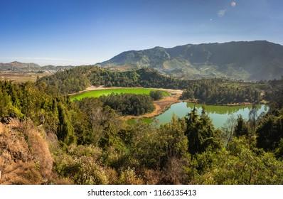 "TELAGA WARNA at left lake and TELAGA PENGILON at right lake, means ""color lake"" and ""mirror lake"". Beautiful panorama view from Batu Pandang point in Dieng Plateau."