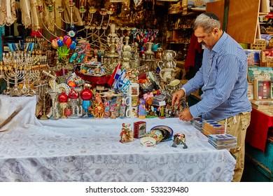 """Tel-Aviv - 4 December, 2016: The """"Carmel"""" market in Tel Aviv and worker"""