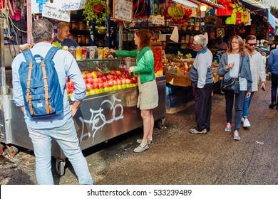 """Tel-Aviv - 4 December, 2016: The """"Carmel"""" market in Tel Aviv and it's visitors"""