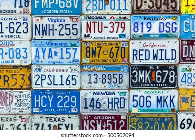Tel-Aviv - August 27: Surface made of an assortment of USA car license plates, on a wall in Tel-Aviv, Israel on August 27, 2016.