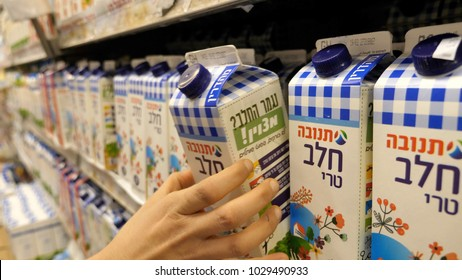 TEL-AVIV - FEB 20, 2018: Buying Israeli milk in a supermarket