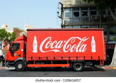 TEL-AVIV, ISRAEL - 07 Jun 2018 : Coca-Cola truck on a street in Tel-Aviv. Side view of a red Coca-Cola truck on a street. Red truck with Coca-Cola logo.
