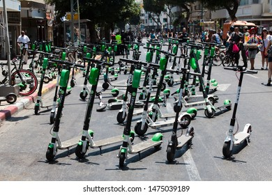 Tel-Aviv, Israel - 14 June 2019: Dozens of parked scooters at the Gay pride parade in Tel-Aviv on a hot summer day, about 250,000 participated.