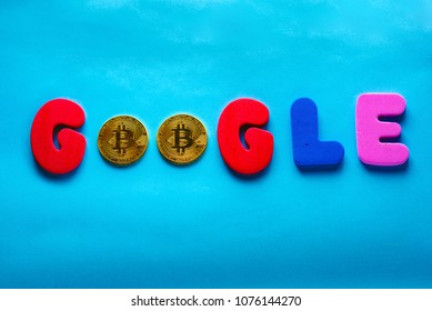 Tel-Aviv, Israel - APRIL 19, 2018: Google - word composed of colored letters and  two Crypto currency bitcoin on blue background. Google is the biggest  Internet search corporation in the world.