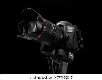 Tel-Aviv, ISRAEL - DECEMBER 05, 2017: Canon 5D Mark IV camera with Canon EF 24-105mm f/4L II USM lens on a black background. Canon is the world largest SLR camera manufacturer.