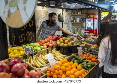 TEL-AVIV, ISRAEL- January 24: Street vendor is selling fruits in Sarona market  on January 24, 2016 in Tel-Aviv. Sarona was a German Templer colony established in Palestine in 1871