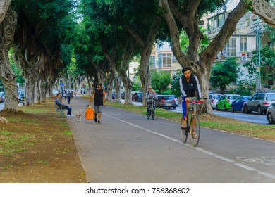 TEL-AVIV, ISRAEL - NOVEMBER 13, 2017: Scene of Chen boulevard, with locals and visitors, in Tel-Aviv, Israel