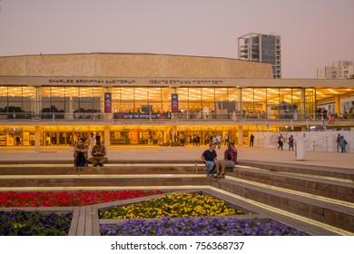 TEL-AVIV, ISRAEL - NOVEMBER 13, 2017: Sunset scene of Ha-Bima square and Leonard Bernstein square, with locals and visitors, in Tel-Aviv, Israel