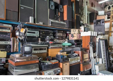 TEL-AVIV, ISRAEL - NOVEMBER 30, 2018: Vintage radio, receivers, tv, speakers and other old electronic devices at Jaffa Flea Market store shelves