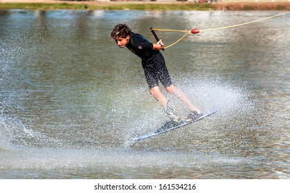 TEL-AVIV, ISRAEL - OCTOBER 26: An unidentified participant shows his skills during Israel Waterski and Wakeboard competition cup onOctober 26, 2013 in Tel-Aviv, Israel.