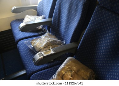 Tel-Aviv/Israel - June 4, 2018: Ben-Gurion Airport and the airplanes  of  Israeli airline El Al. Blue passenger seats, blankets in cellophane and portholes in the cabin