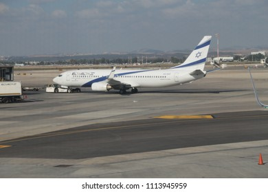 Tel-Aviv/Israel - June 4, 2018: Ben-Gurion Airport and the airplane of Israeli airline El Al on the airfield. Shot through the glass of the passenger hall