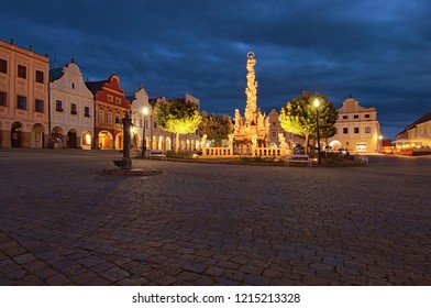 Telc, Czech Republic- AUGUST 24, 2018: Wide angle evening landscape view of main square of Telc with Plague Column and renaissance and baroque colorful houses. A UNESCO World Heritage Site.
