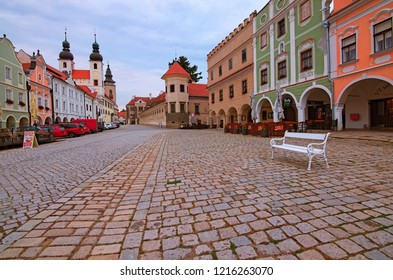 Telc, Czech Republic- AUGUST 25, 2018: Wide angle landscape view of main square in Telc. Colorful renaissance and baroque houses, Name of Jesus Church and tower of the Church of St. Jakub.