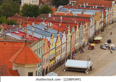 Telc, Czech Republic- AUGUST 25, 2018: Aerial view of colorful buildings with red tile roofs at the medieval square in Telc. Tourists are walking. Summer landscape. UNESCO World Heritage Site