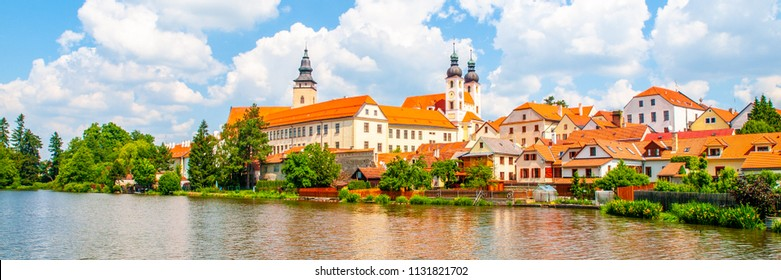 Telc Panorama. Water reflection of houses and Telc Castle, Czech Republic. UNESCO World Heritage Site.