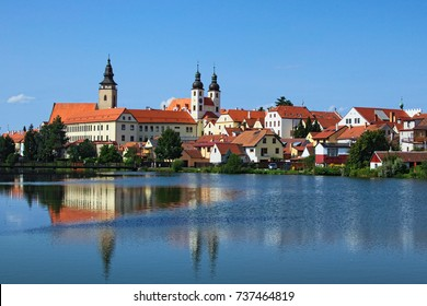 Telc is a town in southern Moravia in the Czech Republic. Telc Castle and city reflected in lake. A UNESCO World Heritage Site.