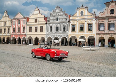 "Telc, Vysocina Region, CZ - JUN 10, 2008 - Square ""Zacharias of Hradec"" at the city of Telc with a red sports car"