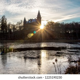 Teleborg Castle (Teleborg Slott)  in Vaxjo in the region Smaland in Sweden during winter time with frozen lake. Scenic view with reflection