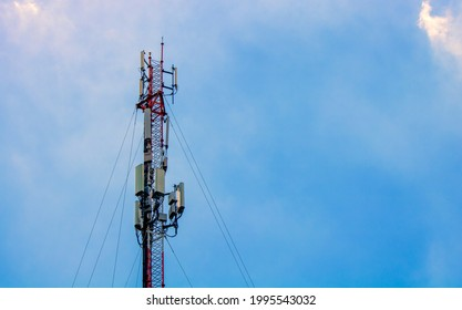 Telecom, (Close up) Single Telecom mast or Telecommunication mast TV antennas wireless technology with blue sky background, Show tower infrastructure.
