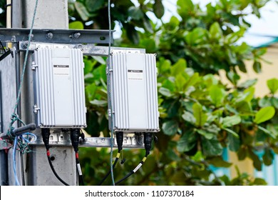 Telecom Power Supplies for Base Station or Base Transceiver Station and Wireless Communication Antenna Transmitter on Electricity post.