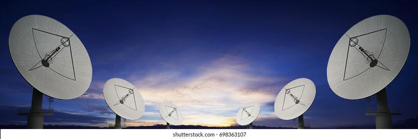 Telecom satellite array and sunset Panoramic background