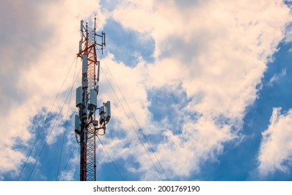 Telecom, Single Telecom mast or Telecommunication mast TV antennas wireless technology with cloudy blue sky background, Show tower infrastructure. (Fall colors Effect edit)