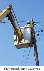 A Telecom/Electrical Engineer using a Mobile Elevating Work Platform Machine.