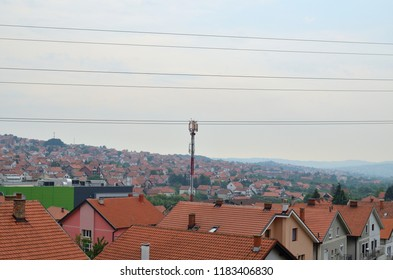 Telecommunication antenna on a tower in a middle of suburban area