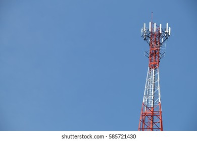 Telecommunication antenna tower with blue sky and have copy text