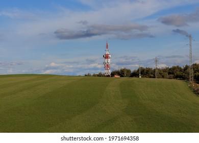 Telecommunication antenna tower in green field