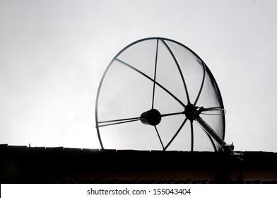 Telecommunication concept. Old satellite antenna - bad communication